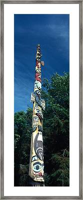 Low Angle View Of A Totem Pole, Totem Framed Print