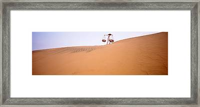 Low Angle View Of A Woman Carrying Framed Print by Panoramic Images