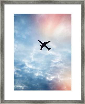 Low Angle View Of Airplane Flying In Framed Print by Maurice Rivera / Eyeem