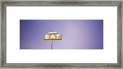 Low Angle View Of An Old Sign Board Framed Print