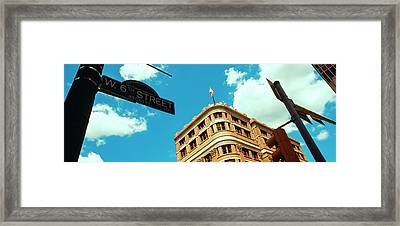 Low Angle View Of Building With Road Framed Print by Panoramic Images