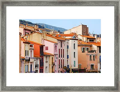 Low Angle View Of Buildings In A Town Framed Print