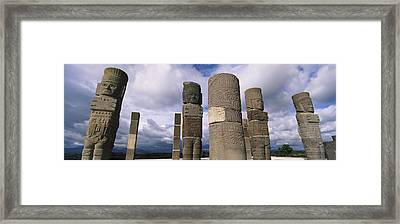 Low Angle View Of Clouds Over Statues Framed Print