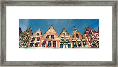 Low Angle View Of Gabled Houses Framed Print
