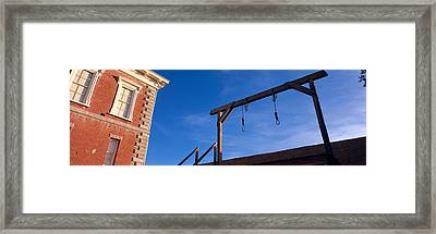 Low Angle View Of Gallows, Tombstone Framed Print by Panoramic Images