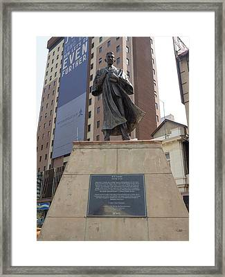 Low Angle View Of Mahatma Gandhi Statue Framed Print