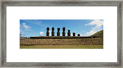 Low Angle View Of Moai Statues Framed Print by Panoramic Images
