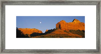 Low Angle View Of Moon Over Red Rocks Framed Print