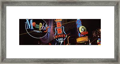 Low Angle View Of Neon Signs Lit Framed Print by Panoramic Images