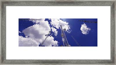 Low Angle View Of Radio Antennas Framed Print by Panoramic Images