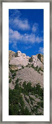 Low Angle View Of Sculptures Of Us Framed Print by Panoramic Images