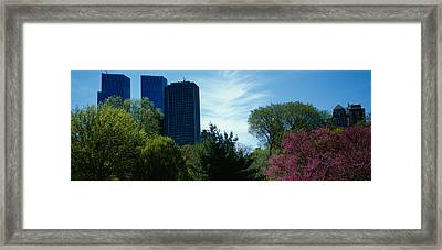 Low Angle View Of Skyscrapers Viewed Framed Print by Panoramic Images