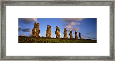 Low Angle View Of Statues In A Row Framed Print