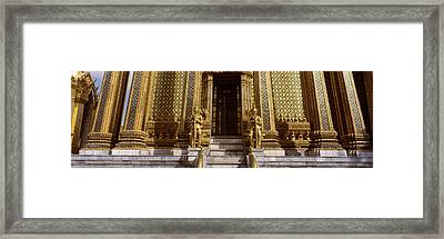 Low Angle View Of Statues In Front Framed Print by Panoramic Images