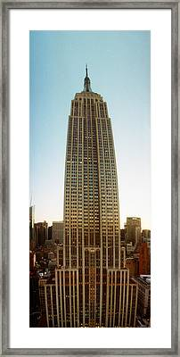 Low Angle View Of The Empire State Framed Print by Panoramic Images