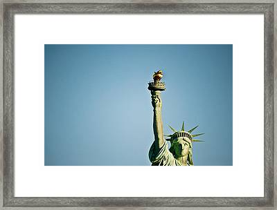 Low Angle View Of The Statue Of Framed Print