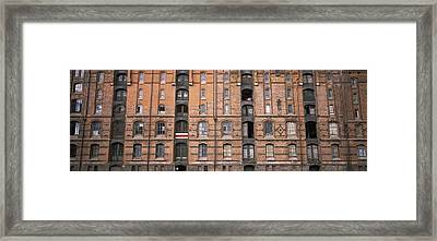 Low Angle View Of Warehouses In A City Framed Print