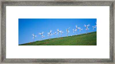 Low Angle View Of Wind Turbines Framed Print by Panoramic Images