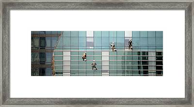 Low Angle View Of Window Washer Framed Print by Panoramic Images