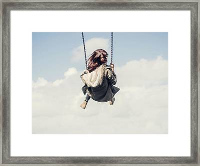 Low Angle View Of Woman On Swing Framed Print by Denise Kwong / Eyeem