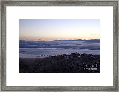 Low Lying Clouds In Waves Before Sunrise Over Jerome Arizona Framed Print