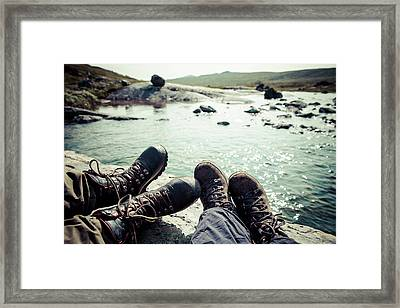 Low Section Of Women Sitting On Rock At Framed Print by Katja Kircher