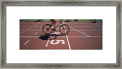 Low Section View Of A Man Cycling Framed Print by Panoramic Images