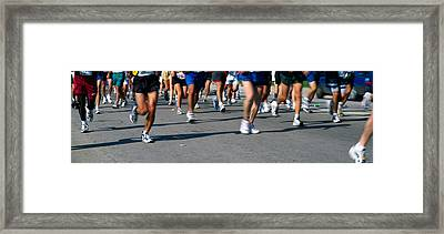 Low Section View Of People Running Framed Print