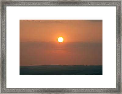 Low Setting Sun Over Distant Landscape Framed Print by Matthew Gibson