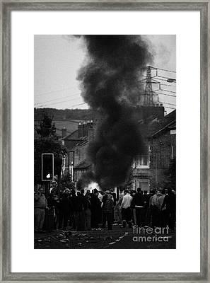 loyalist protestors block the road in front of burning vehicle on the Albertbridge Road Belfast Nort Framed Print by Joe Fox