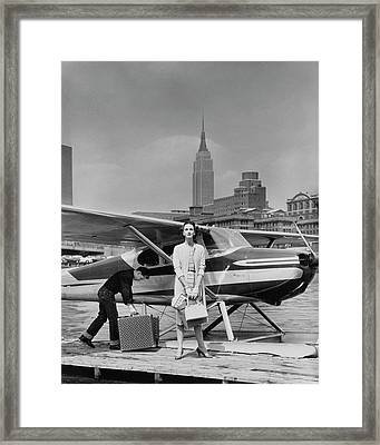 Lucille Cahart With Small Plane In Nyc Framed Print by John Rawlings