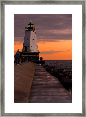 Ludington Pier And Lighthouse Framed Print by Sebastian Musial