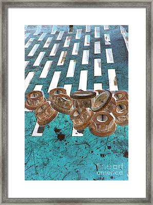 Lug Nuts On Grate Vertical Turquoise Copper Framed Print by Heather Kirk