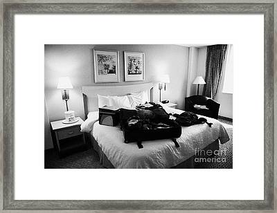 Luggage Lying On King Size Bed In A Us Hotel Room Miami Florida Usa Framed Print by Joe Fox