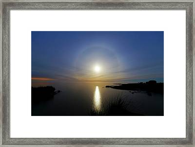Lunar Halo Over Water Framed Print by Luis Argerich