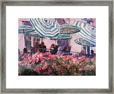 Lunch Under Umbrellas Framed Print by Kris Parins
