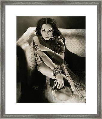 Lupe Velez Sitting On A Sofa Framed Print by Edward Steichen