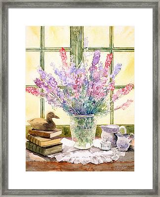 Lupins On Windowsill Framed Print by Julia Rowntree