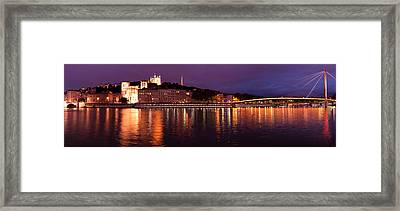 Framed Print featuring the photograph Lyon At Dusk by Phyllis Peterson