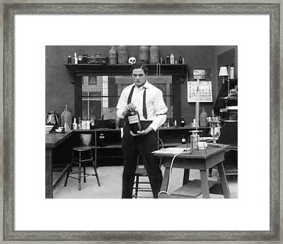 Mad Scientist In His Lab Framed Print by Underwood Archives