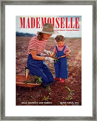 Mademoiselle Cover Featuring A Mother And Baby Framed Print by Fernand Fonssagrives