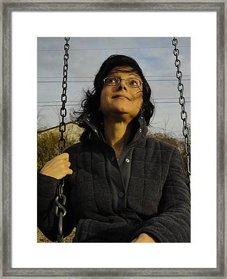Madness Rides A Swing Framed Print by Guy Ricketts
