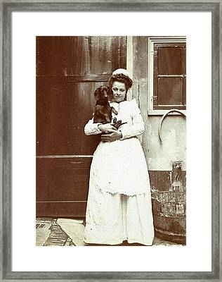 Maid With A Dachshund In Her Arms At An Outside Tap Framed Print