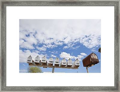Mailboxes Against Sky Framed Print by David Litschel