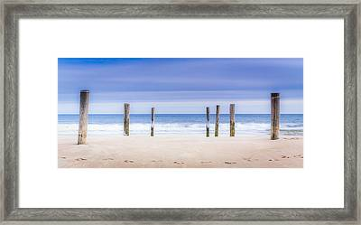 Main Beach Pilings Framed Print by Ryan Moore