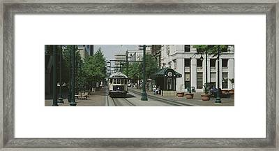 Main Street Trolley Court Square Framed Print by Panoramic Images