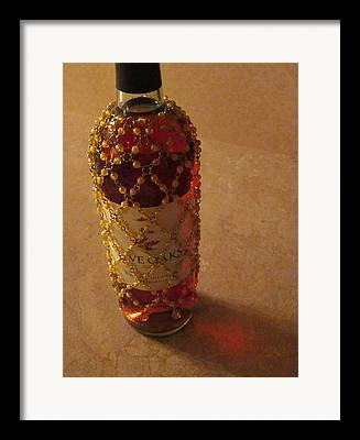 The White Wine Bottle In Its Netting Casts A Red Ethereal Glow On The Framed Prints