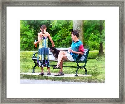 Making A New Friend In The Park Framed Print by Susan Savad