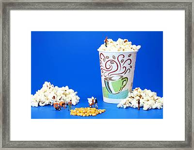 Making Popcorn Framed Print by Paul Ge