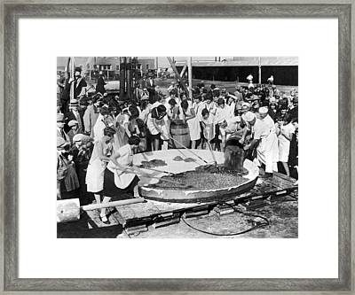 Making The World's Largest Apple Pie Framed Print by -